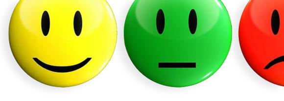 20111116_ Medewerkers vinden collega's meest bepalend bij geluk in werk - happy sad face on white - no source 580x206